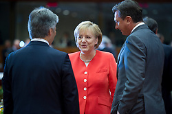 Angela Merkel, Germany's chancellor, center, speaks with Werner Faymann, Austria's chancellor, left, and Borut Pahor, Slovenia's prime minister, during the European Summit meeting at EU Council headquarters in Brussels, Belgium, on Thursday, June 17, 2010. (Photo © Jock Fistick)