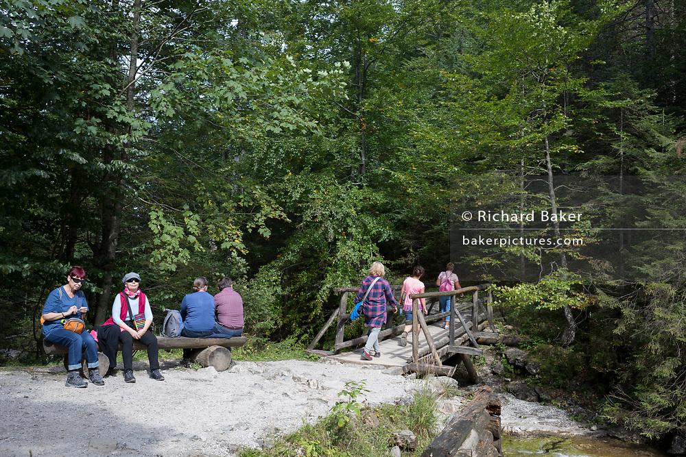 Hikers rest on the footpath near Sarnia Skala, a mountain in the Tatra National Park, on 16th September 2019, near Koscielisko, Zakopane, Malopolska, Poland.
