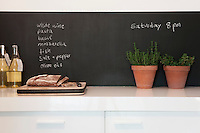 Chalkboard with kitchen herbs