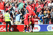 Thats 3-0 Walsall FC Midfielder Simeon Jackson is mobbed by his team mates after he scores his 2nd during the EFL Sky Bet League 1 match between Walsall and AFC Wimbledon at the Banks's Stadium, Walsall, England on 6 August 2016. Photo by Stuart Butcher.