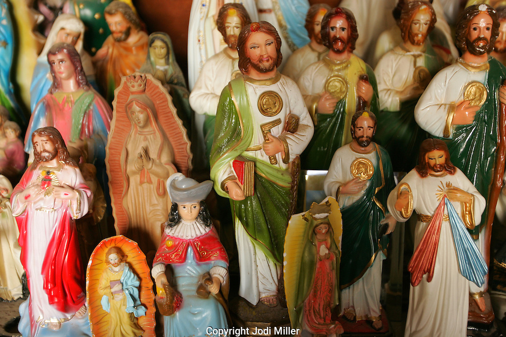 Small statues of saints placed on a table at the San Xavier Mission outside of  Tucson, Az.