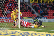 Doncaster Rovers Forward John Marquis (9) is taclked by Bristol Rovers Defender Marc Bola during the EFL Sky Bet League 1 match between Doncaster Rovers and Bristol Rovers at the Keepmoat Stadium, Doncaster, England on 27 January 2018. Photo by Craig Zadoroznyj.