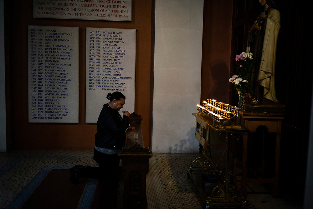 A devoted woman praying after Sunday mass at St. Mary's Pro-Cathedral in Dublin City centre, on May 13, 2018.