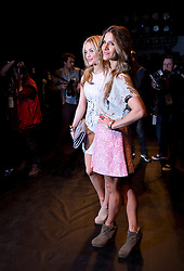 © London News Pictures. 15/02/2013. London, UK.  Amanda Byram (Right) and Laura Whitmore attend the Zoe Jordan show during London Fashion Week Winter/Autumn 2013/14 on February 15, 2015. Photo credit : Ben Cawthra/LNP