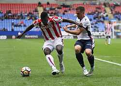 Mame Biram Diouf of Stoke City (L) and Andrew Taylor of Bolton Wanderers in action - Mandatory by-line: Jack Phillips/JMP - 29/07/2017 - FOOTBALL - Macron Stadium - Bolton, England - Bolton Wanderers v Stoke City - Pre-Season Club Friendly