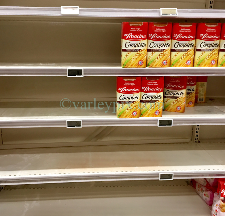 23 March 2020. Montreuil Sur Mer, Pas de Calais, France. <br /> Coronavirus - COVID-19 in Northern France.<br /> <br /> Shelves have been mostly stripped of flour at Leclerc supermarket in Attin near Montreuil Sur Mer. <br /> <br /> Numbers entering the store at any one time are restricted to try and maintain 'social distancing,' in an effort to halt the spread of the virus. Anyone leaving their home must carry with them an 'attestation,' in a effect a self administered permit to allow them out of the house. If stopped by the police, one must produce a valid permit along with identification papers. Failure to do so is punishable with heavy fines. Movement in France has been heavily restricted by the government.<br /> <br /> Montreuil Sur Mer was the headquarters of the British Army under Field-Marshal Sir Douglas Haig from March 1916 to April 1919. Over 1,200 year old, the ancient fortified  town with its high ramparts has endured through history, surviving the plague and King Henry VIII's invasion of France in 1544 when the Duke of Norfolk under Henry VIII's command laid a disastrous siege to the town which held firm until Norfolk was forced to withdraw in 1545. Residents are confident the ancient town can survive the coronavirus too. <br /> Photo©; Charlie Varley/varleypix.com
