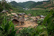 A village lies below the level of the Nam Kong 1 dam's resevoir. Once completed, the area will be submerged in water. Most of the villagers have already abandoned their homes, with a few returning each day to tend to the livestock left behind.