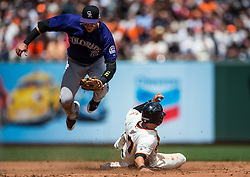 Troy Tulowitzki (#2) jumps over Gregor Blanco (#7)