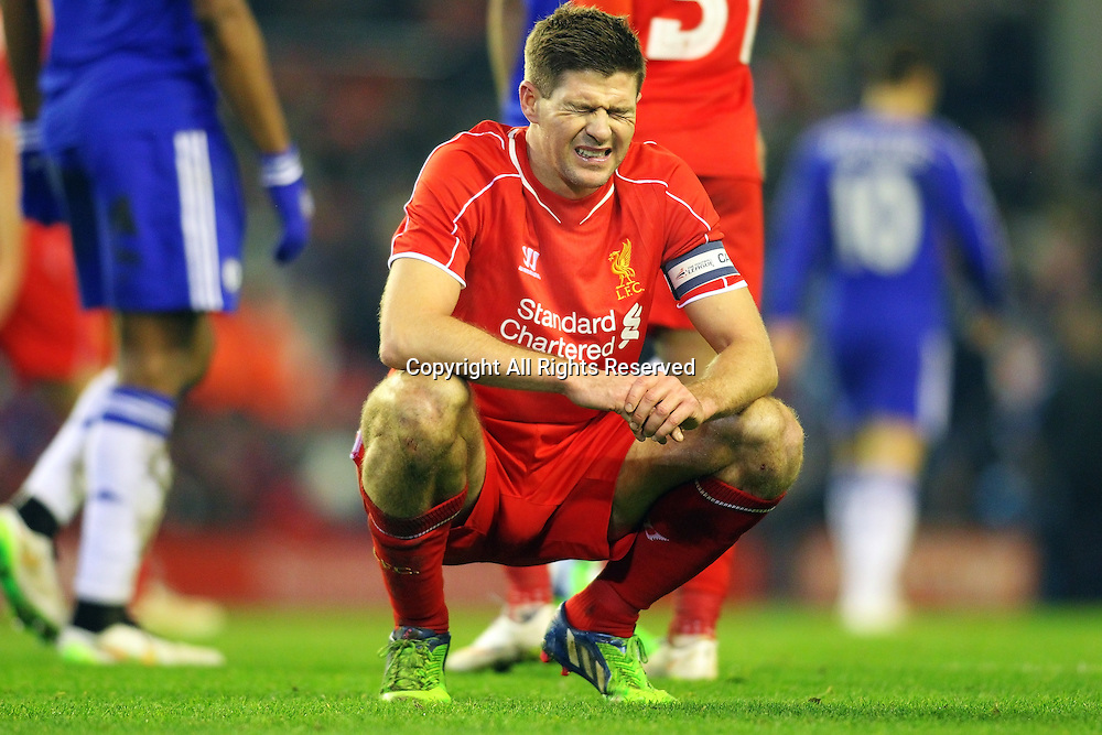 20.01.2015.  Anfield, Liverpool, England. Capital One Cup Semi Final. Liverpool versus Chelsea. Gerrard of Liverpool winces at a missed chance as his shot comes back from the post