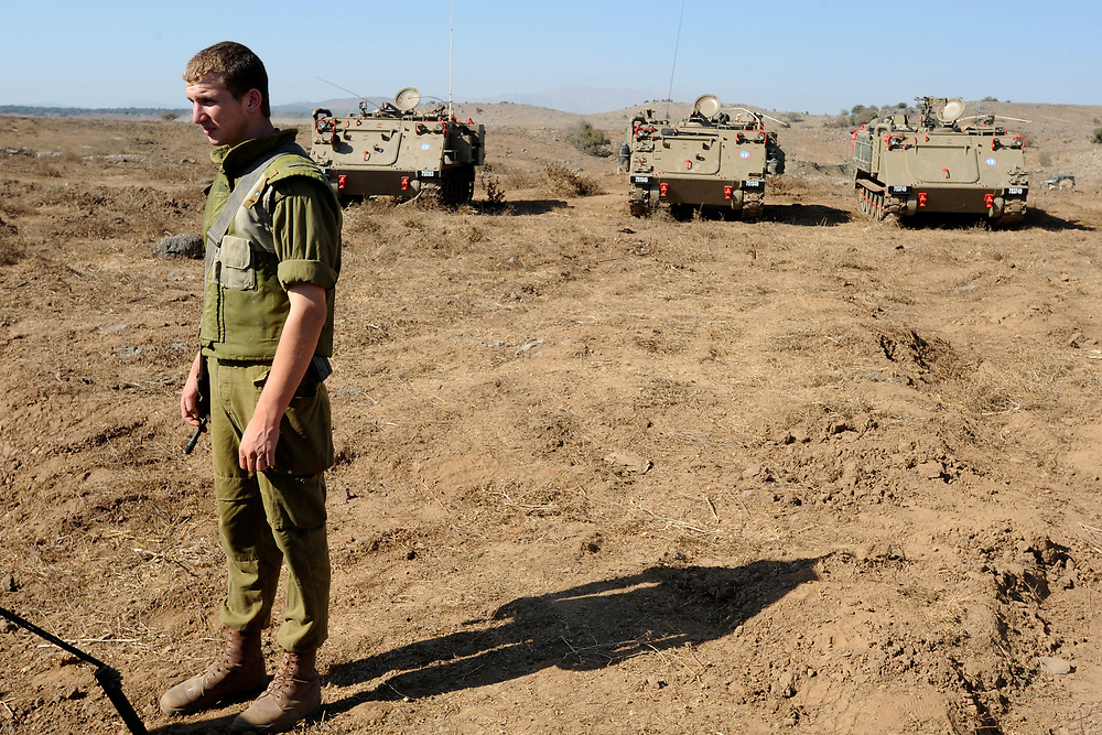 GOLAN HEIGHTS, UNSPECIFIED - AUGUST 30: An Israeli soldiers guards a military field camp on August 30, 2013 near the border with Syria, in the Israeli-annexed Golan Heights. Tensions is rising in Israel amid talks of a military intervention In Syria. Photo by Gili Yaari