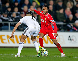 Raheem Sterling of Liverpool is challenged by Neil Taylor of Swansea City - Photo mandatory by-line: Rogan Thomson/JMP - 07966 386802 - 16/03/2015 - SPORT - FOOTBALL - Swansea, Wales — Liberty Stadium - Swansea City v Liverpool - Barclays Premier League.