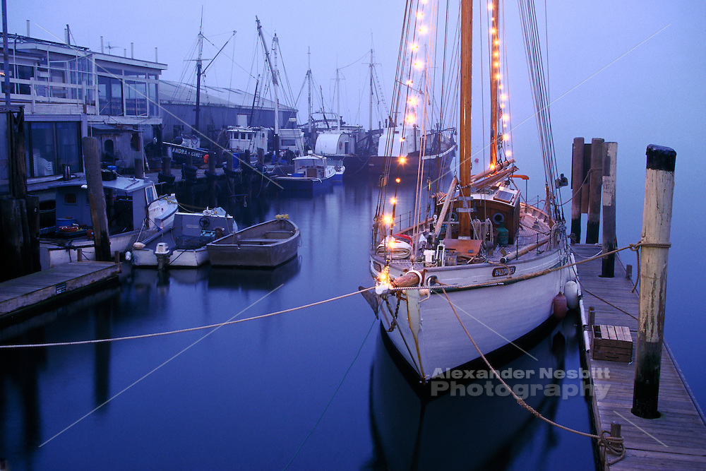 USA - Newport, RI - former flagship of Capetown, the Yacht 'Halloween' lies at her slip at Bowen's landing on a foggy winter evening.