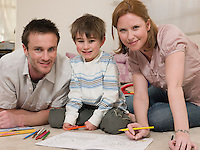 Parents on Floor Coloring With Son