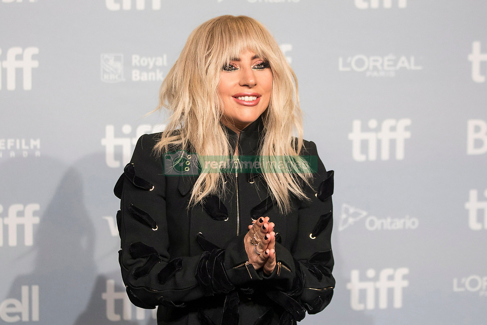 "Lady Gaga gestures as she leaves a photo call before appearing at the press conference for ""Gaga: Five Foot Two"" at the Toronto International Film Festival, in Toronto on Friday, September 8, 2017. Photo by Chris Young/Canadian Press /ABACAPRESS.COM"