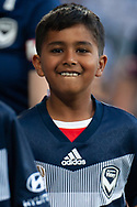 Young Victory fans smiling prior to kick off at the Hyundai A-League Round 4 soccer match between Melbourne Victory and Central Coast Mariners at AAMI Park in Melbourne.
