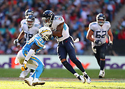 LONDON, ENGLAND - OCTOBER 21: outside linebacker Jatavis Brown (57) of The Chargers of The Chargers tackles wide receiver Tajae Sharpe (19) Of The Titans during the NFL game between Tennessee Titans and Los Angeles Chargers at Wembley Stadium on October 21, 2018 in London, United Kingdom. (Photo by Mitchell Gunn/Pro Lens Photo Agency) *** Local Caption *** Tajae Sharpe; Jatavis Brown