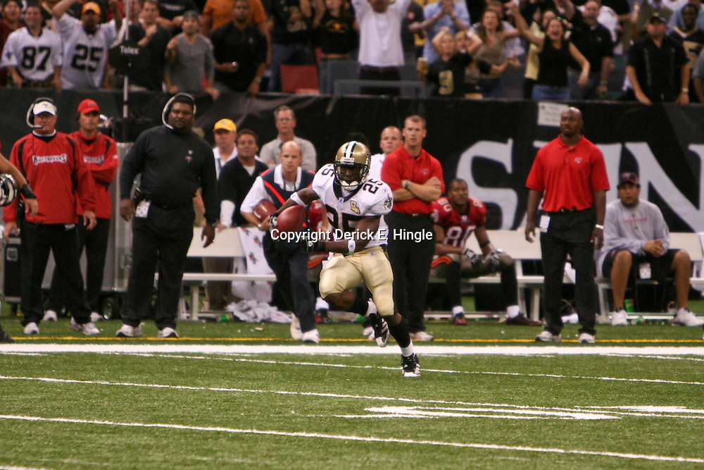 Oct. 8, 2006; New Orleans, LA, USA; New Orleans Saints running back (25) Reggie Bush runs back a 65-yard punt return against the Tampa Bay Buccaneers during the fourth quarter at the Louisiana Superdome in New Orleans, LA. The touchdown return was the first score in Bush's NFL career. Mandatory Credit: Derick E. Hingle