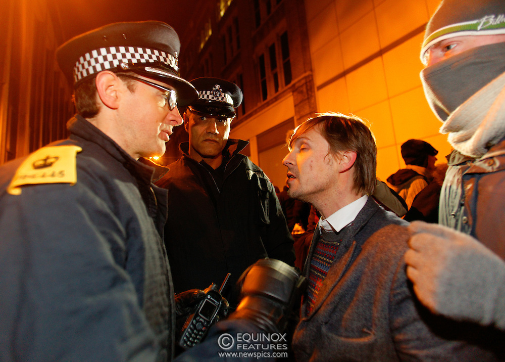 London, United Kingdom - 30 January 2012.Sergeant Delroy Smellie (center) from the Metropolitan Police Territorial Support Group who was charged and cleared of assaulting a female protester at a G20 protest. Police and bailiffs clash with Occupy London protesters and their supporters as they evict them from the Occupy Bank of Ideas site. The campaigners had formed a self styled Earl Street Community Space in part of a building owned by UBS Bank, Earl Street, City of London, London, England, UK..Copyright: ©2012 Equinox Licensing Ltd. +448700 780000 - Contact: Equinox Features - Date Taken: 20120130 - Time Taken: 031924+0000 - www.newspics.com