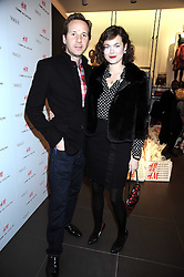 GAWAIN RAINEY and JASMINE GUINNESS at a preview of the H&M Comme des Garcons collection held at H&M Regent Stret, London on 12th November 2008.