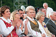 Lithuanian Song Celebration (Song and Dance Festival) 90th anniversary, Vilnius, Lithuania (6 July 2014). Pictured here, Lithuanian President Dalia Grybauskaite watches the Song Day as it is performed in Vingis Park, Vilnius. © Rudolf Abraham.