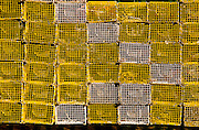 Lobster traps reflected in the water in Spruce Head harbor, Maine