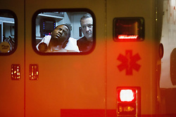 July 24, 2017 - Chicago, Illinois, U.S. - Paramedics treat a man who was shot in the ankle near the intersection of West 87th Street and South Eggleston Avenue. At least six people were killed and 35 others were wounded in weekend violence in Chicago as the number of homicides continues. (Credit Image: © Armando L. Sanchez/TNS via ZUMA Wire)