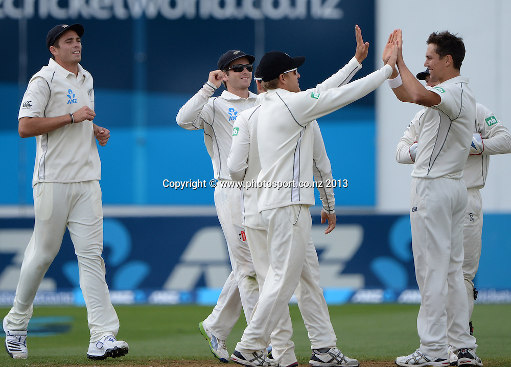 Trent Boult celebrates with team mates on Day 3 of the 2nd cricket test match of the ANZ Test Series. New Zealand Black Caps v West Indies at The Basin Reserve in Wellington. Friday 13 December 2013. Mandatory Photo Credit: Andrew Cornaga www.Photosport.co.nz