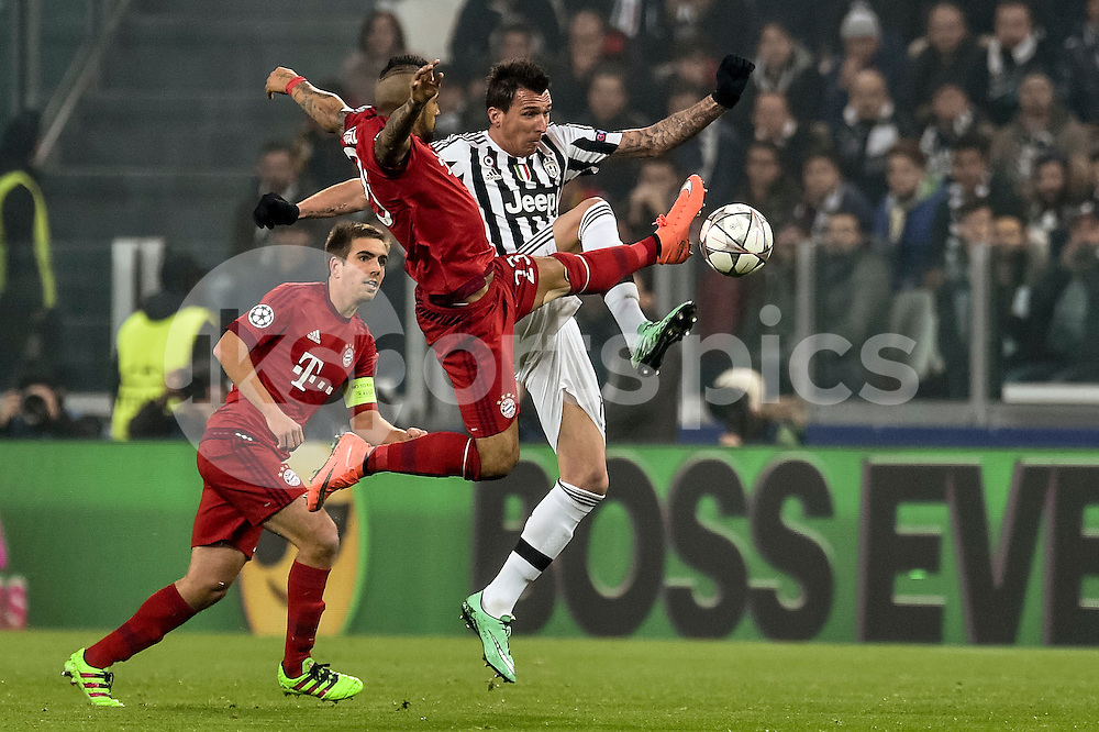 Arturo Vidal of Bayern Munchen challenges Mario Mandzukic   of Juventus  during the UEFA Champions League match Round of 16 between Juventus and Bayern Munich at the Juventus Stadium, Turin, Italy on 23 February 2016. Photo by Giuseppe Maffia.
