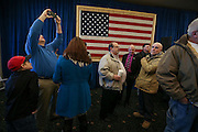 Two hours early, supporters in the VIP section wait for Republican presidential candidate Donald Trump to arrive at a town hall meeting in Windham,  N.H. Monday, Jan. 11, 2016.  CREDIT: Cheryl Senter for The New York Times