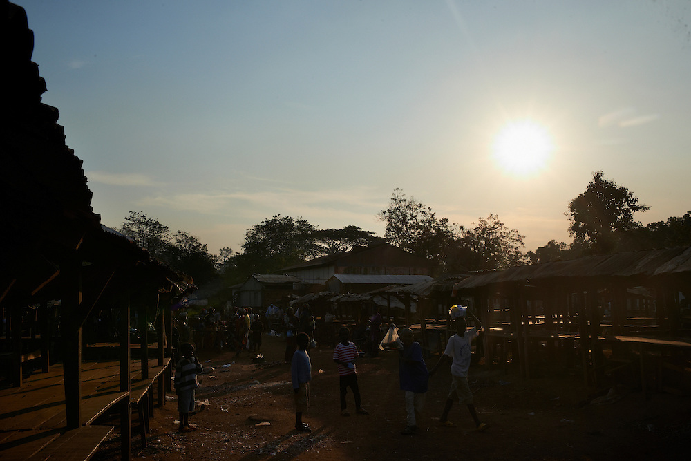 The market at sunset in the town of Boda, Lobaye District, Central African Republic (CAR) on December 1, 2013. CRS and partner organisation Caritas has provided immediate food security support to vulnerable households in the Lobaye Prefecture in the south west of CAR. Targeting 1,811 food insecure families, or 10,866 total beneficiaries, vouchers were distributed to vulnerable households which could be exchanged for food items at local markets. The program helps support families and also strengthen the local market structure.