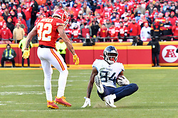Jan 19, 2020; Kansas City, Missouri, USA; Kansas City Chiefs strong safety Tyrann Mathieu (32) tackles Tennessee Titans wide receiver Corey Davis (84) during the first half in the AFC Championship Game at Arrowhead Stadium. Mandatory Credit: Denny Medley-USA TODAY Sports