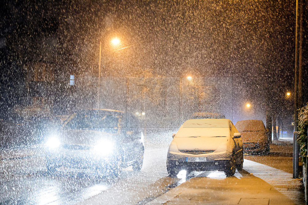 """© Licensed to London News Pictures. 12/01/2017. Luton, UK. Heavy snowfall on roads in Luton, Bedfordshire for the first time this winter, on January 12, 2017. Weather warnings are in place across the UK as a """"polar maritime airmass"""" from northern Canada spreads across the country, bringing snow, ice, rain and freezing temperatures. Photo credit: Ben Cawthra/LNP"""
