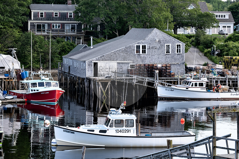 Lobster boats tied up to a lobster wharf New Harbor, Maine.   The tiny picturesque pocket harbor is one of the last working harbors on the midcoast along the Pemaquid Peninsula