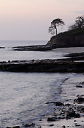 View of Pacific rocky sea shore at dawn, Pacheca Island, Las Perlas Archipelago, Panama, Central America.