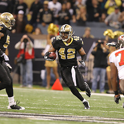 Dec 27, 2009; New Orleans, LA, USA;  New Orleans Saints safety Darren Sharper (42) runs with the ball after intercepting a pass against the Tampa Bay Buccaneers during the first quarter at the Louisiana Superdome. Mandatory Credit: Derick E. Hingle-US PRESSWIRE..