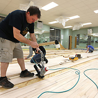 Waylon Earnest, an installer with The Court Company, of Memphis, nails in new flooring in the aerobics room at the Wellness Center. The NMMC Wellness Center will start the new year with a shiny, fresh floor for its aerobics room. The floor had been refinished several times and couldn't be sanded further. The new floor is expected to be ready for happy feet by mid-January. The center, which will celebrate its 30th anniversary in September 2019, has also replaced saunas, installed a new heater for its whirlpool and incorporated new fitness equipment over the past year. It remains the only Medical Fitness Association certified facility in Mississippi.