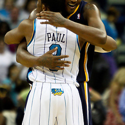 April 3, 2011; New Orleans, LA, USA;Former teammates New Orleans Hornets point guard Chris Paul (3) and Indiana Pacers small forward James Posey (41) hug following a game at the New Orleans Arena. The Hornets defeated the Pacers 108-96.  Mandatory Credit: Derick E. Hingle