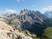"The peaks of the Cadini Group jut high in the Sesto Dolomites near Cortina d'Ampezzo, Italy, Europe. In the Cadini di Misurina, Cima Grande rises to 2999 meters (9839 feet), between Cima Piccola and Cima Ovest. Hike for spectacular views around Tre Cime di Lavaredo (Italian for ""Three Peaks of Lavaredo,"" or in German called Drei Zinnen, ""Three Merlons""). The Dolomites are part of the Southern Limestone Alps, in northern Italy, Europe. UNESCO honored the Dolomites as a natural World Heritage Site in 2009."