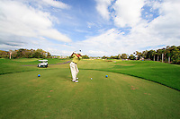 Teeing off at the the Sea Temple golf course in Port Douglas, far north Queensland, Australia. Shot 3 in a series of 6.