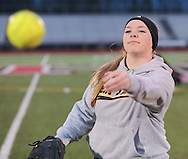 Hatboro-Horsham softball player Jen Cader throws a softball during practice Friday, March 13, 2015 in Horsham, Pennsylvania. (Photo by William Thomas Cain/Cain Images)