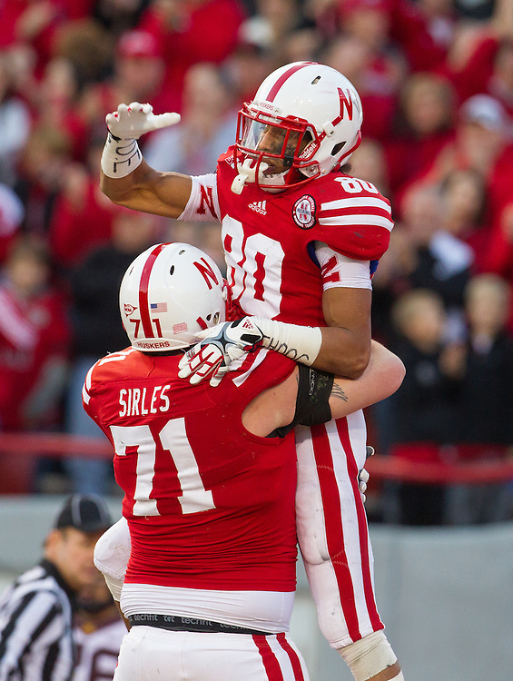 Kenny Bell #80 and Jeremiah Sirles #71 of the Nebraska Cornhuskers celebrate after Bell's second touchdown during Nebraska's 38-14 win over the Gophers on Nov. 17, 2012 at Memorial Stadium.