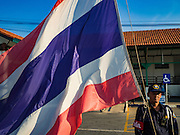 01 MARCH 2016 - CHACHOENGSAO, THAILAND: Thai railway police raise the Thai flag at the train station in Chachoengsao, Thailand. Flags are raised at government buildings and schools across Thailand at 8AM every day.     PHOTO BY JACK KURTZ