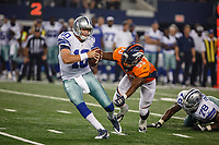 28 AUG 2014: Dallas Cowboys quarterback Dustin Vaughan (10) spins out of a sack attempt by Denver Broncos linebacker Steven Johnson (53) during the final NFL American Football Herren USA preseason game between the Denver Broncos and Dallas Cowboys at AT&T Stadium in Arlington, TX. NFL American Football Herren USA AUG 28 Preseason - Broncos at Cowboys PUBLICATIONxINxGERxSUIxAUTxHUNxRUSxSWExNORxONLY Icon140828784<br />