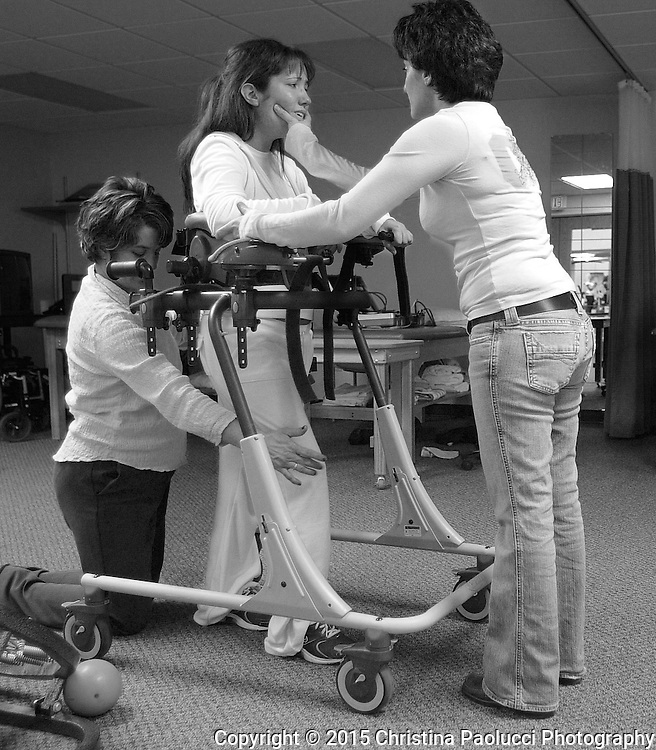 Denise tries to encourage Brooke to keep trying at Team Rehab in Decorah, Iowa.  Brooke was really struggling to keep moving her legs after two hours while working with Physical Therapist Lisa Krieg.  <br /> (Rochester Post-Bulletin, Christina Paolucci)