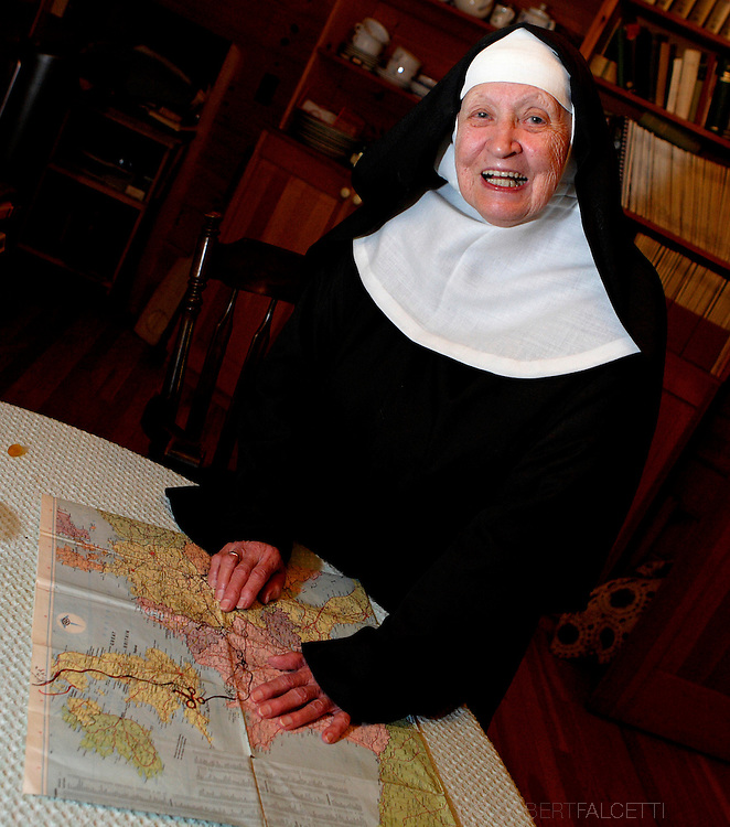BETHLEHEM, CT-16 OCTOBER 2007-101607BF23-- Mother Irene Boothroyd, an 87-year-old a Benedictine nun at the Abbey of Regina Laudis, served as a nurse in the Army Nurse Corps during World War II. Here she looks over a map of Europe.  .Photo by Robert Falcetti
