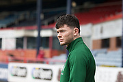 17th March 2019, Dens Park, Dundee, Scotland; Ladbrokes Premiership football, Dundee versus Celtic; Oliver Burke of Celtic inspects the pitch before the match
