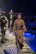 Japan, Tokyo : TOKYO, JAPAN - MARCH 16: Models showcase designs on the runway during the Jotaro Saito show as a part of Mercedes Benz Fashion Week TOKYO A/W 2016/2017 at Shibuya Hikarie on March 16, 2016 in Tokyo, Japan.