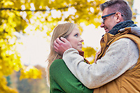 Portrait of handsome man showing affection to his wife in park