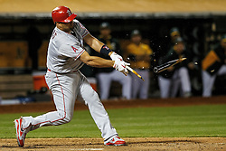 OAKLAND, CA - JUNE 17:  Albert Pujols #5 of the Los Angeles Angels of Anaheim breaks his bat on a ground out during the ninth inning against the Oakland Athletics at the Oakland Coliseum on June 17, 2016 in Oakland, California. The Oakland Athletics defeated the Los Angeles Angels of Anaheim 3-2. (Photo by Jason O. Watson/Getty Images) *** Local Caption *** Albert Pujols