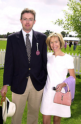 MR & MRS HANS RAUSING members of the multi millionaire Tetra pak packaging family, at a polo match in Berkshire on 30th July 2000.OGN 76
